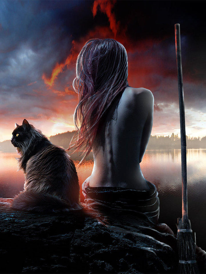 Witch and cat by the lake