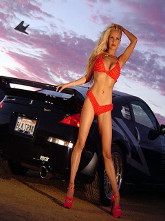 Blonde in red and a car