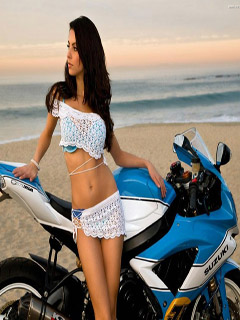 Hot girl with a bike by the sea