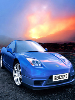 Car against sunset backdrop