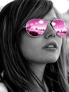 In pink sunglasses