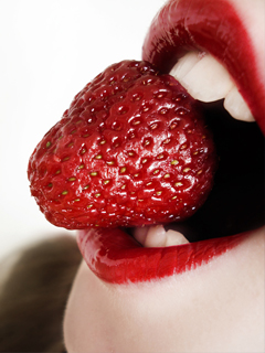 Strawberry in mouth