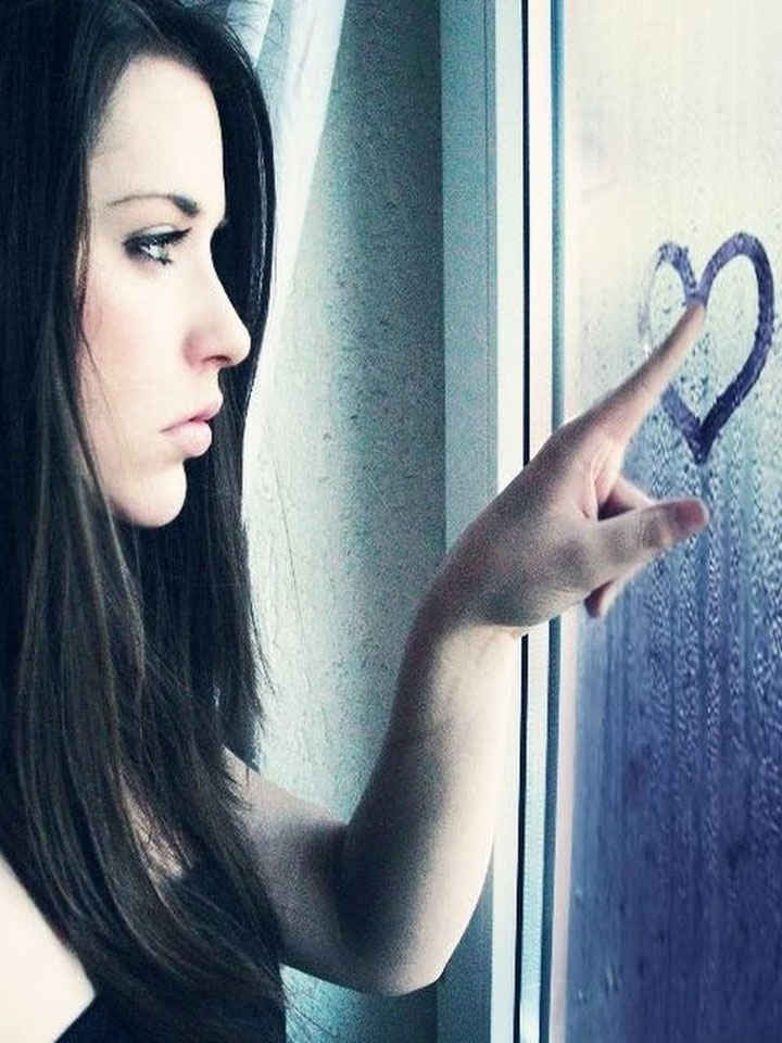 Girl and heart on window