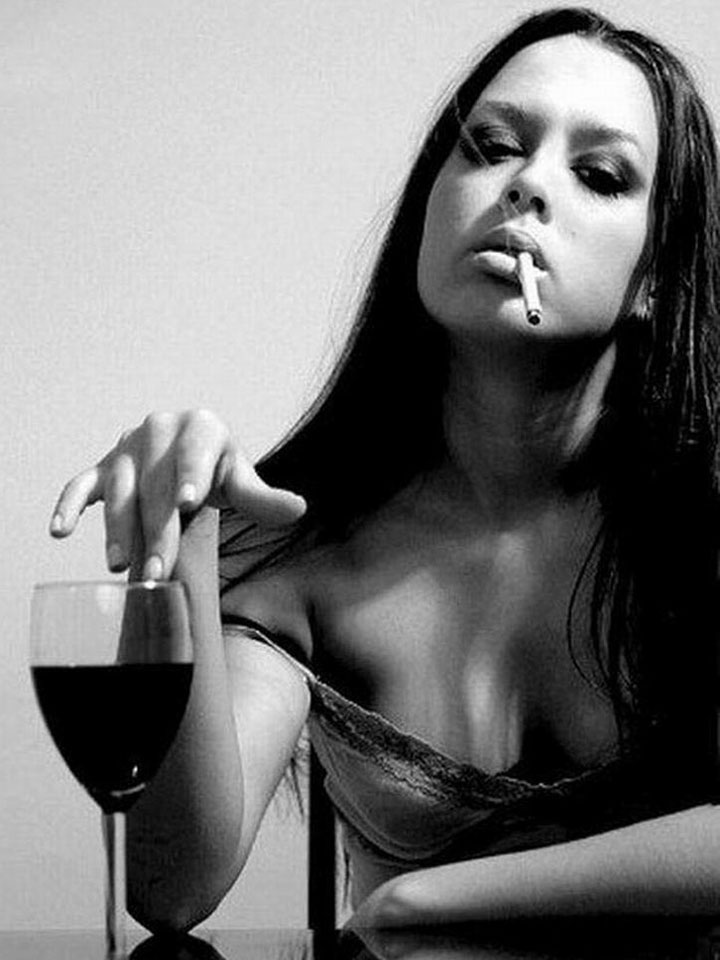Smoking woman and a glass of wine